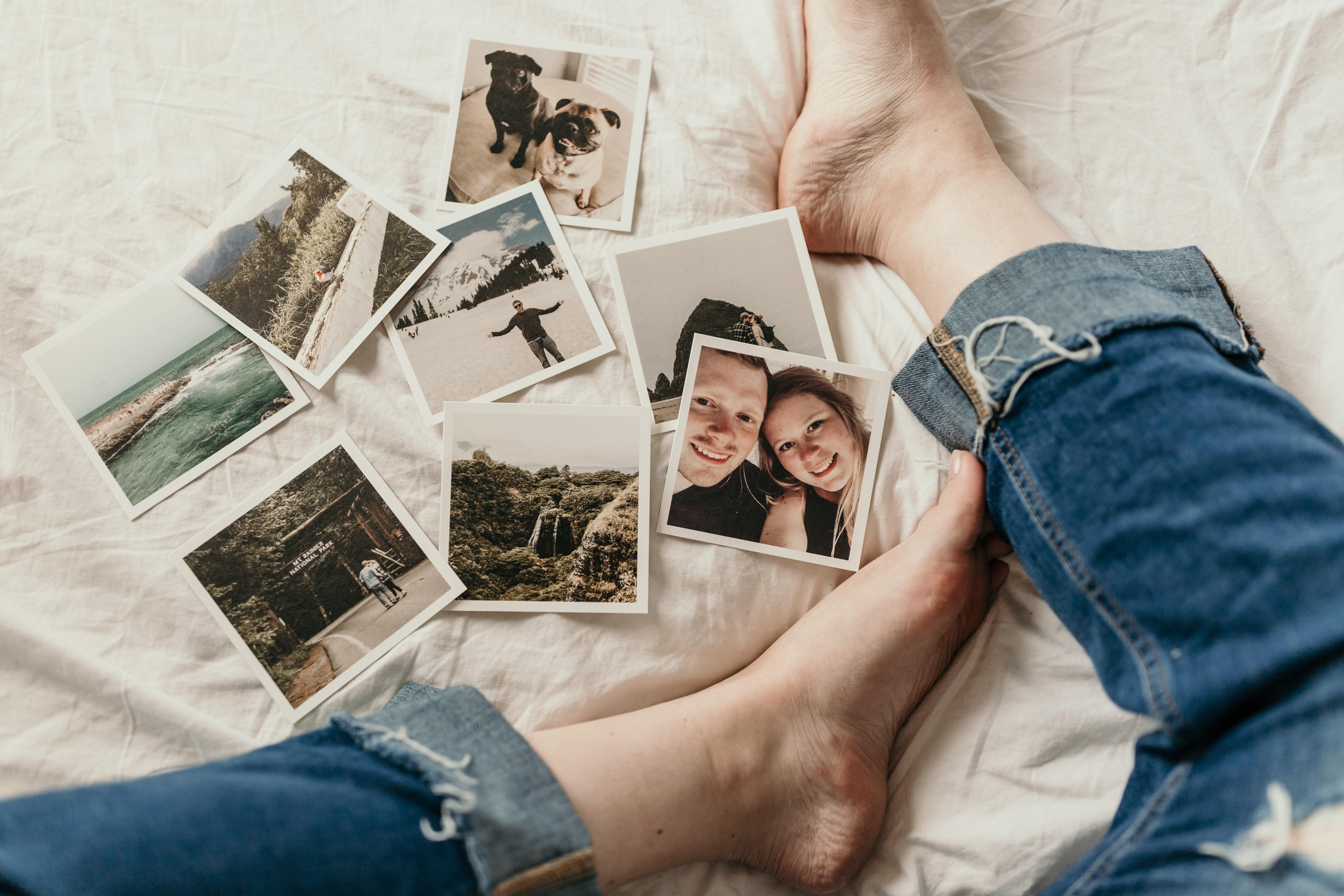 a person's feet with polaroid photos