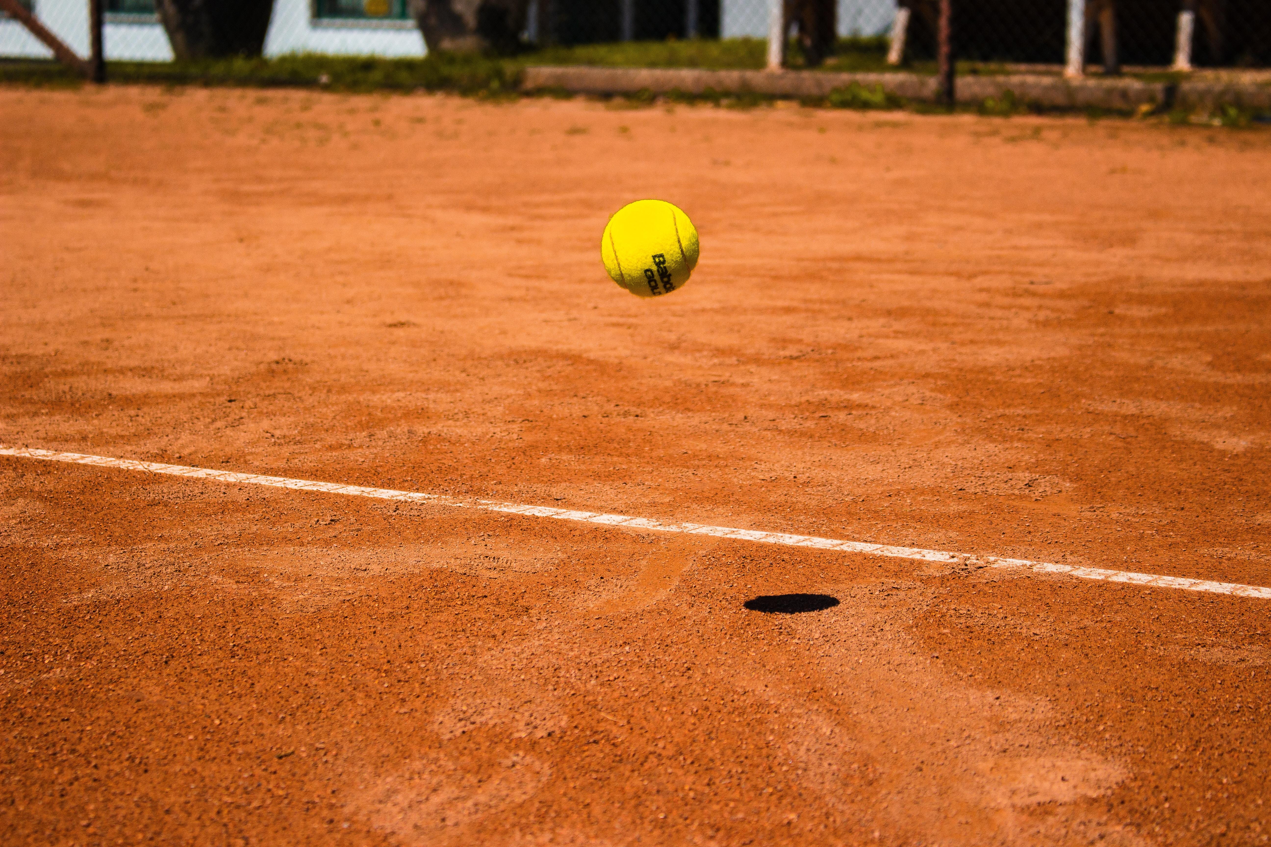 Tennis ball bouncing on a court